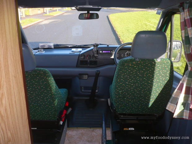 The cab, complete with panoramic view and swivel seats.