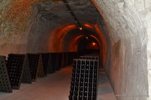 The endless bottles and thick chalk walls at Taittinger's cellars.