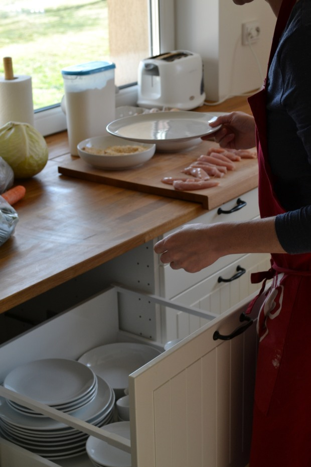 Making chicken goujons.  Featured IKEA items include METOD drawer with MAXIMERA interior, HAMMARP worktop, LAMPLING cutting board, JAMKA storage box and VINTER 2014 apron.