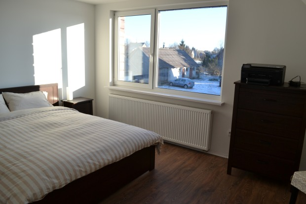 East Bedroom. Featured IKEA items include BRUSALI bed, side tables and chest of drawers and INGOLF chair with cushion.